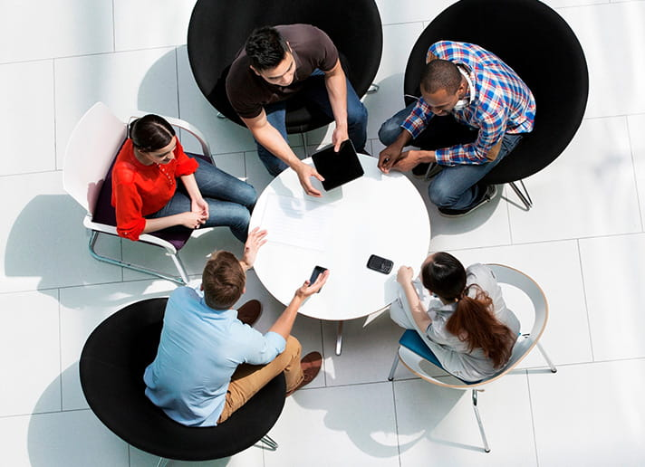 Overhead of people around circle table