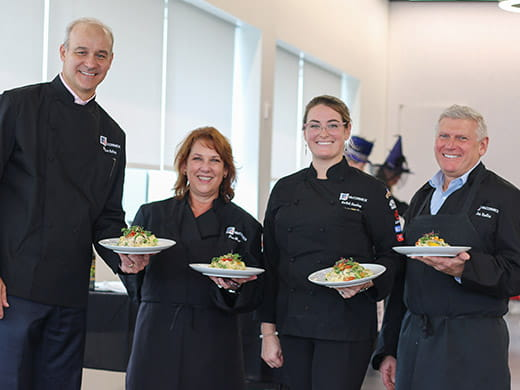 McCormick Management Hosts Cooking Challenge for Charity